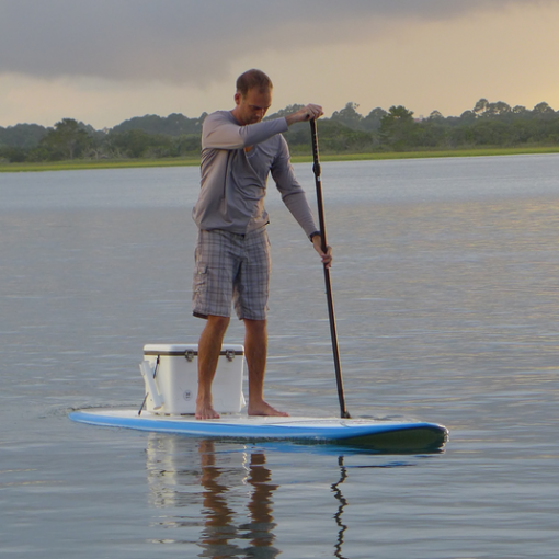sup paddling and fishing with tackle cooler box